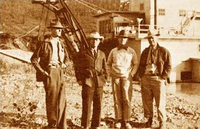 photo of Jack Boswell and associates in front of dredge