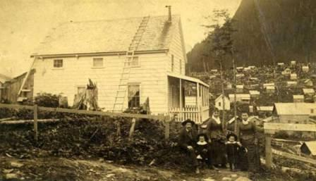 Photo of Richard Harris and family in front of their home in Juneau, 1889.