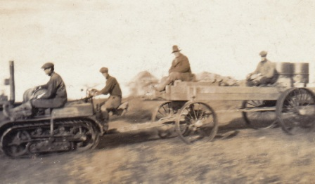 Graphite en route to Imuruk Basin during a test haul, circa 1917; Nick Tweet is seated on the wagon, the others are not identified.  Photo from the Tweet family collection.